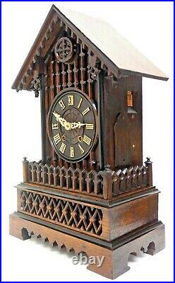 Rare Antique Cuckoo Black Forest Carved Mantel Clock made in Germany Circa 1870